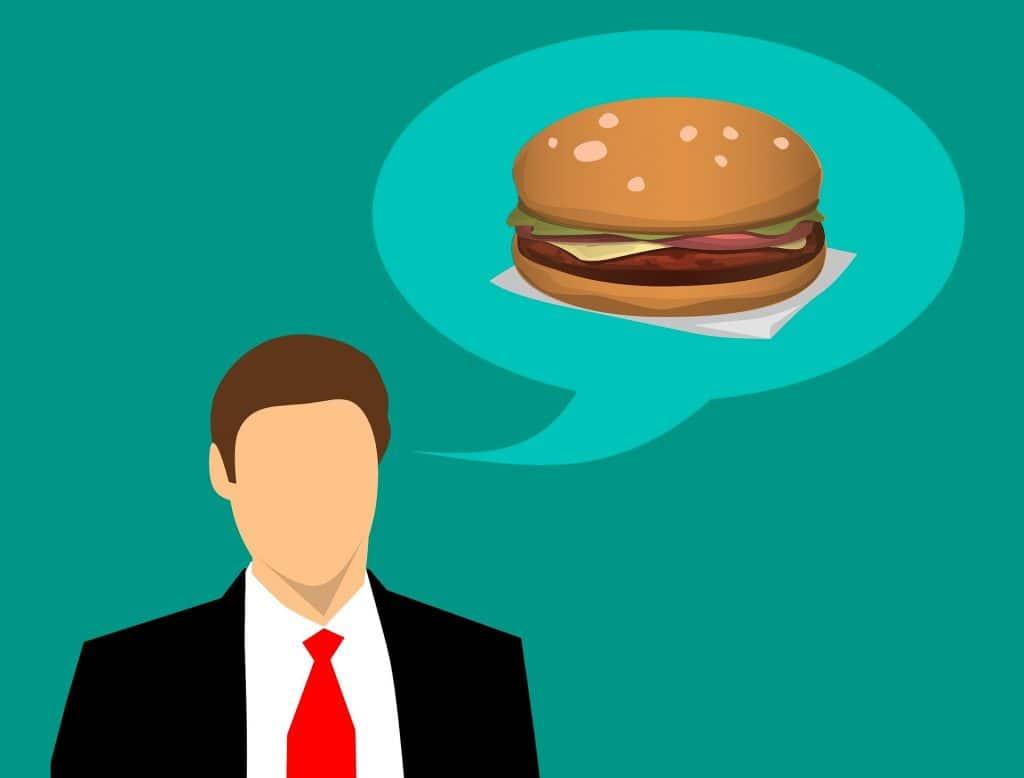 Homme qui pense à un burger